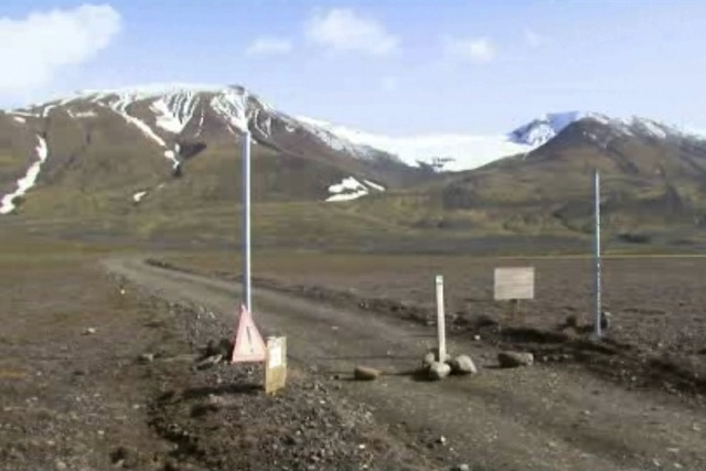 This is a Aug. 19, 2014 file image taken from video of  a sign is posted on the road next to Bardarbunga, a subglacial stratovolcano located under Iceland's largest glacier.  (AP Photo/Courtesy Ch ...