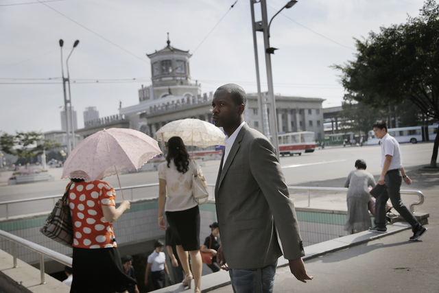 Two-time Grammy award winning rapper and a founding member of the Fugees, Pras Michel, poses for a picture, Sunday, Aug. 31, 2014 in downtown Pyongyang, North Korea. The American rapper and docume ...