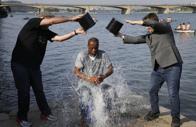 Two-time Grammy award winning rapper and a founding member of the Fugees, Pras Michel, gets doused by his friends for the ALS Ice Bucket Challenge, Sunday, Aug. 31, 2014 in Pyongyang, North Korea. ...