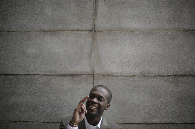 Two-time Grammy award winning rapper and a founding member of the Fugees, Pras Michel, smiles while speaking to the Associated Press, Sunday, Aug. 31, 2014 in Pyongyang, North Korea. The American  ...