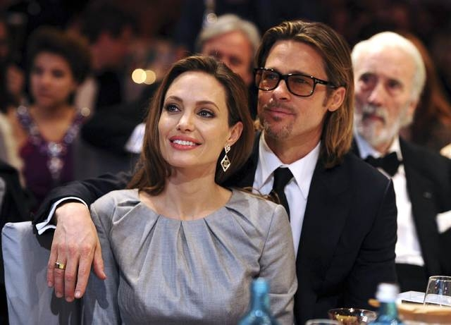 """Angelina Jolie and Brad Pitt attend the """"Cinema for Peace 2012"""" charity gala during the 62nd Berlinale film festival in Berlin on Feb. 13, 2012. The glamorous Hollywood couple dubbed """"Brangelina""""  ..."""