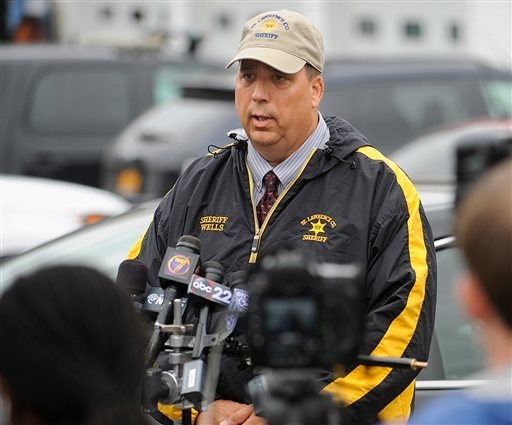 FILE - St. Lawrence County Sheriff Kevin M. Wells briefs the media on Friday, Aug. 15, 2014 in Heuvelton, N.Y., on the investigation into the abduction of two Amish sisters from the familys roadsi ...