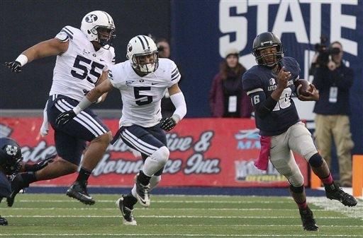 Utah State quarterback Chuckie Keeton (16) runs during an NCAA college football game against Brigham Young on Friday, Oct. 4, 2013, in Logan, Utah. The Cougars won 31-7. (AP Photo/The Salt Lake Tr ...