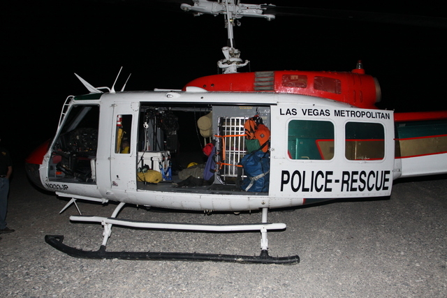 0006: The Las Vegas police helicopter used during a search and rescue mission at Mount Charleston on July 22, 2013, when officer David VanBuskirk fell 25 feet to his death after becoming detached  ...