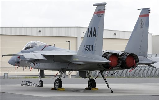 A Massachusetts Air National Guard F-15C fighter aircraft sits near a hangar at Barnes Air National Guard Base, in Westfield, Mass., Wednesday, Aug. 27, 2014. The pilot of an F-15 jet that crashed ...