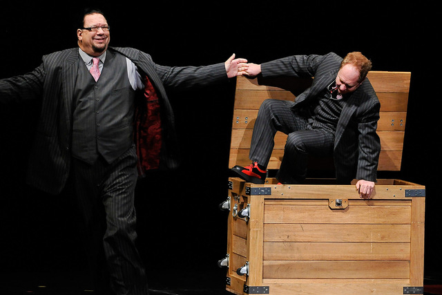Penn Jillette, left, and Teller of Penn & Teller, perform during their show at the Rio hotel-casino on Monday, Aug. 18, 2014. The comedy/magic duo have been entertaining audiences at the Rio for 1 ...