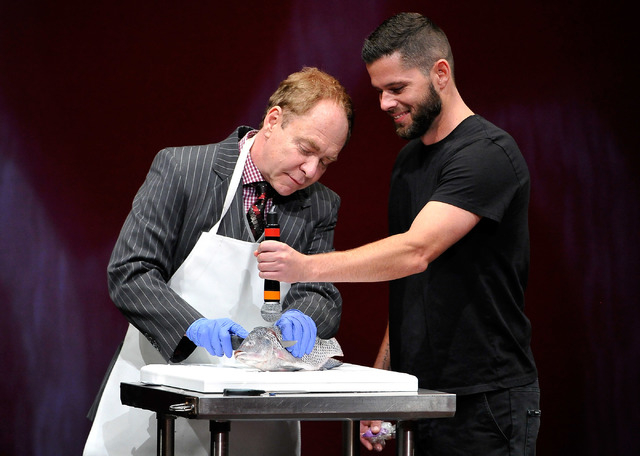 Teller, left, of Penn & Teller performs with a member of the audience during his show at the Rio on Monday, Aug. 18, 2014. (David Becker/Las Vegas Review-Journal)