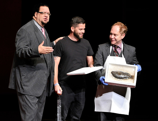 Penn Jillette, left, and Teller of Penn & Teller perform with a member of the audience during their show at the Rio on Monday, Aug. 18, 2014. (David Becker/Las Vegas Review-Journal)