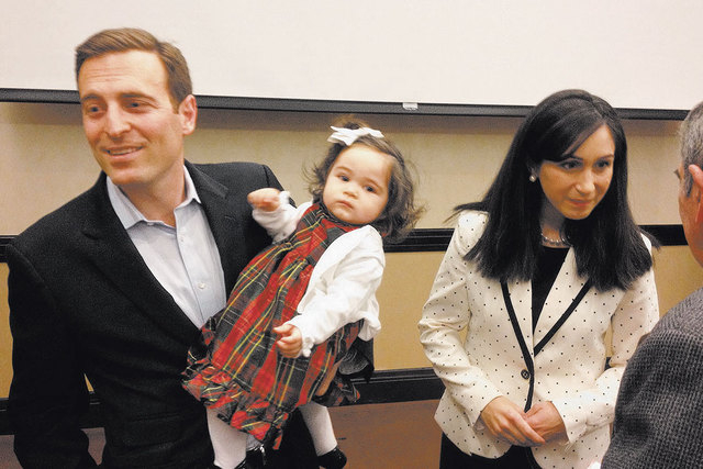 Republican candidate for Nevada attorney general Adam Laxalt is shown in January 2014 holding his daughter, Sophia. His wife, Jaime, is at right. His campaign released military documents on Friday ...