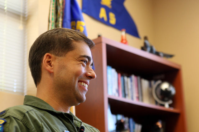 Commander, Lt. Col. Greg Wintill, talks about the F-15 aircraft in the  65th Aggressor Squadron which will be deactivated in September 2014. Wednesday, August 7, 2014 (Michael Quine/Las Vegas Revi ...