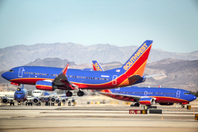 Passengers planes as seen Aug. 6, 2014, at McCarran International Airport. The airport is on pace to serve more than 40 million this year. (Jeff Scheid/Las Vegas Review-Journal)