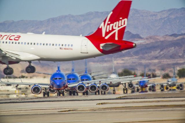 Passengers planes as seen Aug. 6, 2014, at McCarran International Airport. The airport is on a pace to serve more than 40 million this year. (Jeff Scheid/Las Vegas Review-Journal)