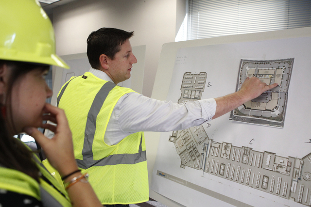 Keith Hansen, right, director of facilities, explains the project plan for the new corporate headquarters of Allegiant Air, 1201 N. Town Center Dr. in Las Vegas, during a tour Wednesday, Aug. 27,  ...