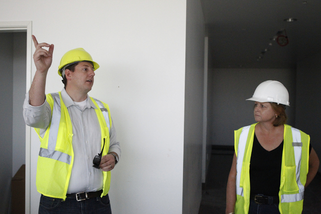 Keith Hansen, left, director of facilities, and Chris Bowen, public relations manager, give a tour of the new corporate headquarters of Allegiant Air, 1201 N. Town Center Dr. in Las Vegas Wednesda ...