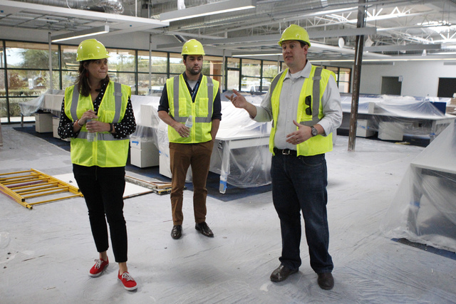 Jessica Wheeler, from left, public relations manager, Micah Lillard, public relations specialist, and Keith Hansen, director of facilities, give a tour of the new corporate headquarters of Allegia ...