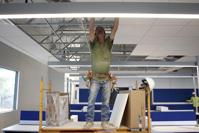 Carpenter Jim Henderson works on the ceiling grid of the future corporate headquarters for Allegiant Air, 1201 N. Town Center Dr. in Las Vegas Wednesday, Aug. 27, 2014. The project is scheduled to ...