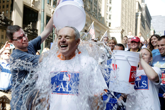 Major League Baseball Commissioner-elect Rob Manfred participates in the ALS Ice-Bucket Challenge outside the organization's headquarters in New York, Wednesday, Aug. 20, 2014. Manfred participate ...