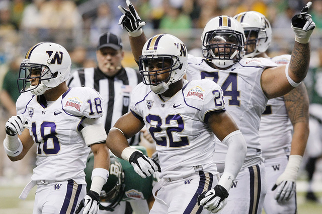 Washington's Josh Shirley (22) celebrates a sack with other Huskies players during the 2011 Alamo Bowl game against Baylor. Shirley has transferred to UNLV and will play this season. (AP Photo/Dar ...