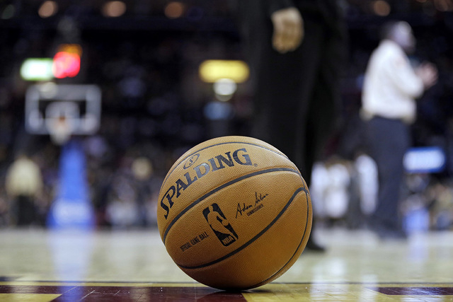 New NBA commissioner Adam Silver's autograph on an official ball during a basketball game between the Sacramento Kings and Cleveland Cavaliers Tuesday, Feb. 11, 2014, in Cleveland. (AP Photo/Mark  ...