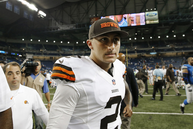 Cleveland Browns quarterback Johnny Manziel (2) walks off the field after losing to the Detroit Lions 13-12 in the a preseason NFL football game at Ford Field in Detroit, Saturday, Aug. 9, 2014. ( ...