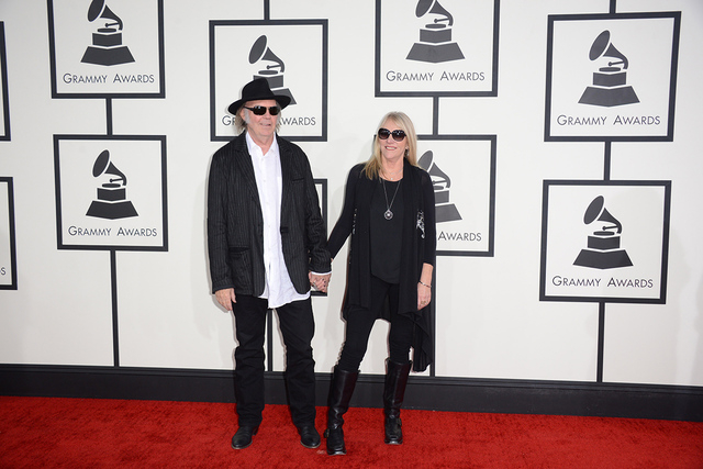 Neil Young, left, and Pegi Young arrive at the 56th annual Grammy Awards at Staples Center on Sunday, Jan. 26, 2014, in Los Angeles. (Jordan Strauss/Invision/AP)