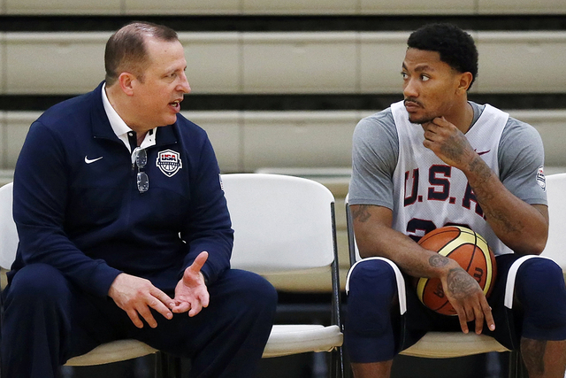 Assistant Coach Tom Thibodeau, left, and Derrick Rose speak during a practice of the men's U.S. National basketball team on Friday, Aug. 15, 2014, in Chicago. The U.S. team will face the Brazilian ...