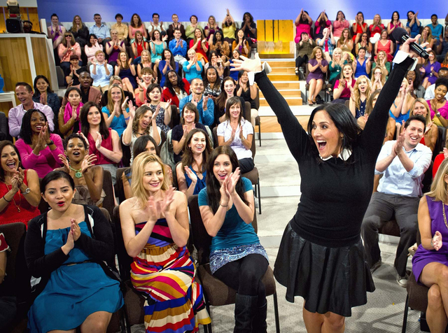 """Host Ricki Lake interacts with her audience during the first day of taping for her daytime talk show """"The Ricki Lake Show""""  in Los Angeles. (AP Photo/20th Television, Barry J. Holmes)"""