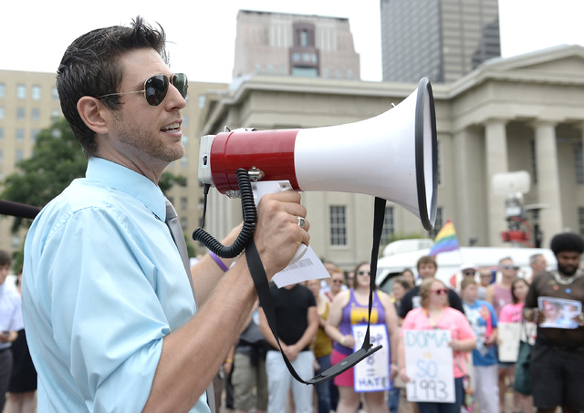 Chris Hartman, Director of the Louisville Fairness Campaign speaks during a rally in support of the U.S. Supreme Court decision on the Defense of Marriage Act June 26, 2013, at Jefferson Suare in  ...