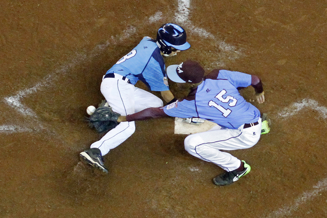 Las Vegas' Dallan Cave (8) scores on a wild pitch by Philadelphia pitcher Kai Cummings (15) in the in the sixth inning of a United States semi-final baseball game at the Little League World Series ...
