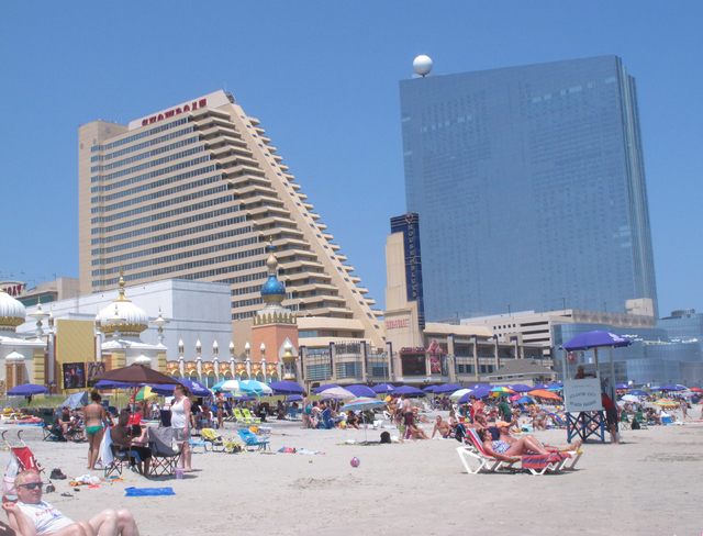 This July 23, 2014 photo shows the Showboat, left, and Revel, right, two Atlantic City N.J. casinos that are due to close by mid-September. Possible uses for former casino buildings include office ...