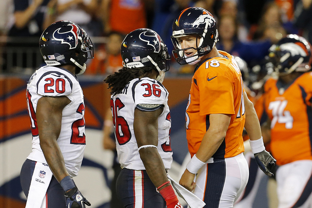 Denver Broncos quarterback Peyton Manning (18) has words for Houston Texans strong safety D.J. Swearinger (36) after a Broncos touchdown during the first half of an NFL preseason football game, Sa ...