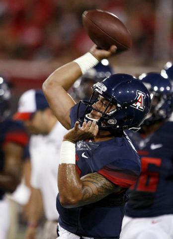 Arizona quarterback Anu Solomon warms up for an NCAA college football game against UNLV, Friday, Aug. 29, 2014, in Tucson, Ariz. (AP Photo/Rick Scuteri)
