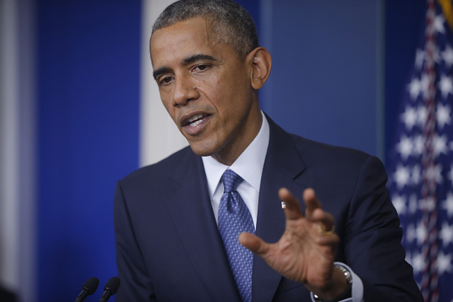 President Barack Obama speaks during a news conference in the James Brady Press Briefing Room at the White House in Washington, Friday, Aug. 1, 2014. (AP Photo/Charles Dharapak)