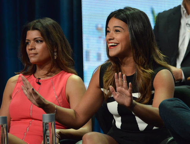 """From left, Andrea Navedo and Gina Rodriguez speak on stage during the """"Jane The Virgin"""" panel at the The CW 2014 Summer TCA held at the Beverly Hilton Hotel on Friday, July 18, 2014, in Beverly Hi ..."""