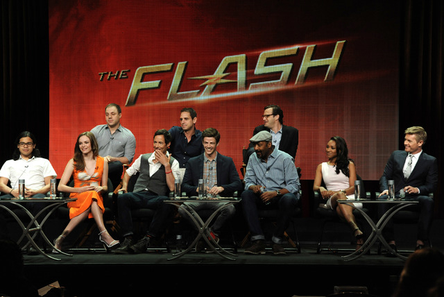 From left, front, Carlos Valdes, Danielle Panabaker, Tom Cavanagh, Grant Gustin, Jesse L. Martin, Candice Patton and Rick Cosnett; rear, Geoff Johns, Chief Creative Officer, DC Entertainment, Exec ...