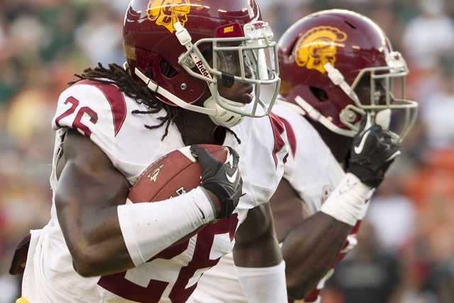 In this Aug. 29, 2013, file photo, Southern California cornerback Josh Shaw (26) runs back an interception for a touchdown against Hawaii during the second quarter of an NCAA college football game ...