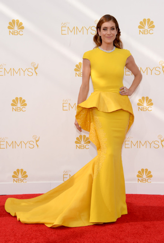 """IMAGE DISTRIBUTED FOR THE TELEVISION ACADEMY - Kate Walsh arrives at the 66th Primetime Emmy Awards at the Nokia Theatre L.A. Live on Monday, Aug. 25, 2014, in Los Angeles. She stars in """"Bad Judge ..."""