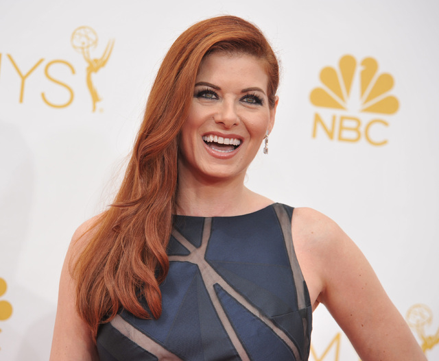 """Debra Messing arrives at the 66th Annual Primetime Emmy Awards at the Nokia Theatre L.A. Live on Monday, Aug. 25, 2014, in Los Angeles. Messing stars in """"The Mysteries of Laura"""" starting Sept. 24  ..."""