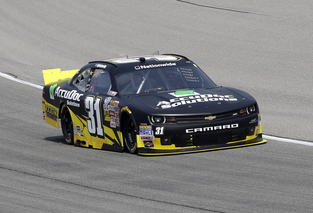 Dylan Kwasniewski (31) drives his car during qualifying for the NASCAR Nationwide Series auto race at Chicagoland Speedway in Joliet, Ill., Saturday, July 19, 2014. (AP Photo/Nam Y. Huh)