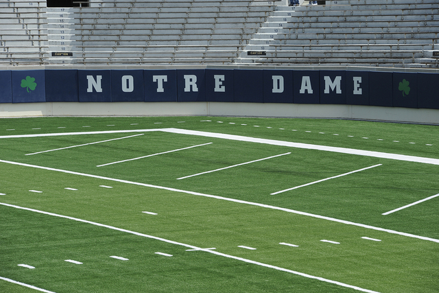 Installation of field turf is completed at Notre Dame football stadium Tuesday July 30, 2014 in South Bend, Ind. Notre Dame is scheduled to open their season against Rice Saturday Aug. 30, 2014 (A ...