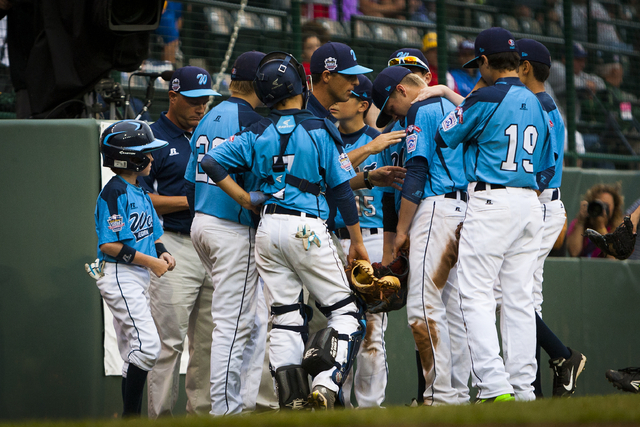 Las Vegas returns to the dugout after Chicago took back the lead during the U.S. Championship Game of the Little League World Series tournament in South Williamsport, Pa., Saturday, Aug. 23, 2014. ...