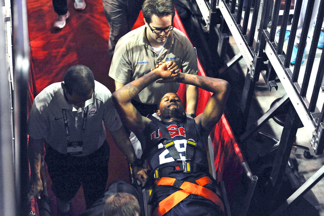 In this photo provided by the Las Vegas News Bureau,  Indiana Pacers' Paul George is carted off the court after breaking his right leg during the USA Basketball Showcase intrasquad game in Las Veg ...