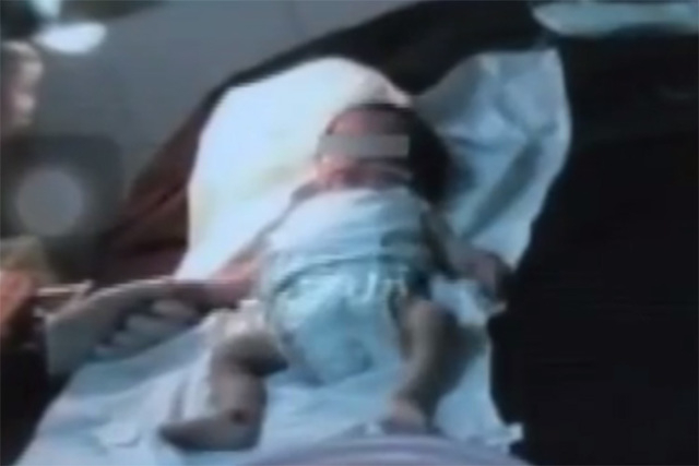 A 2-week-old baby was taken to the morgue by his mom after showing signs of weakness, even though he was still alive. (Screengrab/ABS CBN News/YouTube)