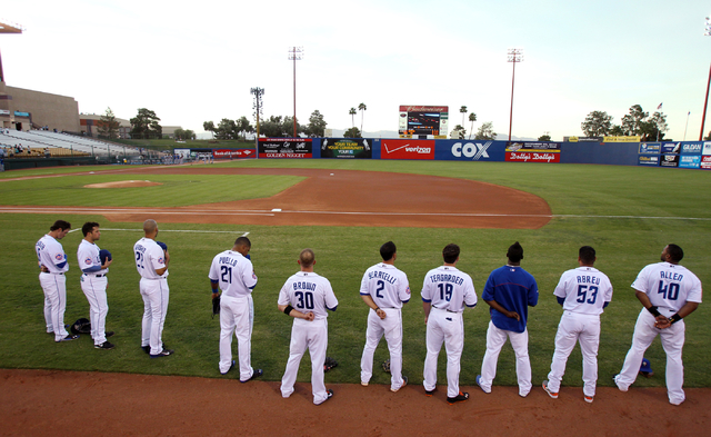 Las Vegas 51s players listen to the National Anthem before taking on the Round Rock (Texas) Express in a baseball game at Cashman Field Monday, Aug. 25, 2014. (K.M. Cannon/Las Vegas Review-Journal)