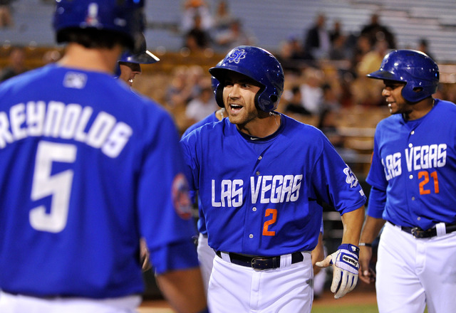 Las Vegas' Anthony Seratelli (2) smiles as he is greeted my teammates, Mat Reynolds (5) and Cesar Puello, after hitting a grand slam home run during the 2nd inning of a baseball game against the R ...