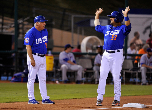 Las Vegas coach Wally Backman, left, speaks with base runner Bobby Abreu at third base during a baseball game against the Round Rock Express at Cashman Field on Tuesday, Aug. 26, 2014. The 51s hav ...