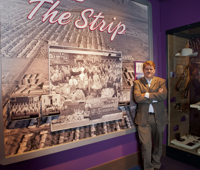 """Geoff Schumacher poses in the National Museum of Organized Crime & Law Enforcement, commonly known as The Mob Museum in Las Vegas, Thursday, June 19, 2014. Schumacher is the editor of """"Nevada ..."""