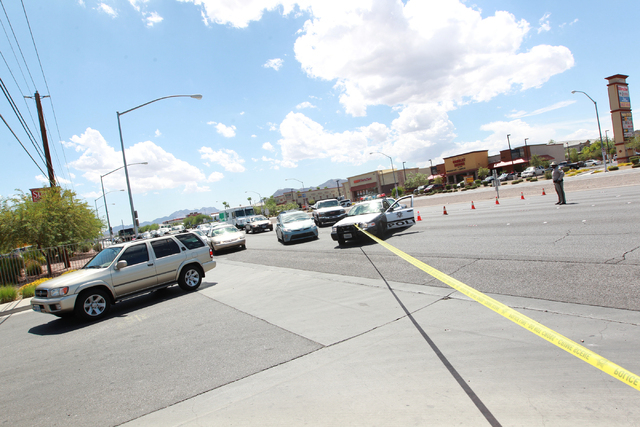 Las Vegas police close off part of northbound Boulder Highway  while responding to a crash involving a truck and a sedan at Boulder Highway and Russell Road in Las Vegas on Wednesday, Aug. 20, 201 ...
