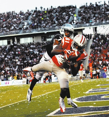 UNLV's Devante Davis (81) hauls in a touchdown pass against UNR's Markus Smith (7) during the second half at Mackay Stadium in Reno on Oct. 26, 2013. (Jason Bean/Las Vegas Review-Journal)