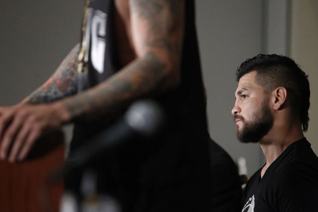 Fighter Bryan Vera listens to his opponent Gabriel Rosado during a press conference for their upcoming Saturday bout in the first card for Big Knockout Boxing at Mandalay Bay Events Center in Las  ...